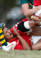 rugby player getting hit in the head